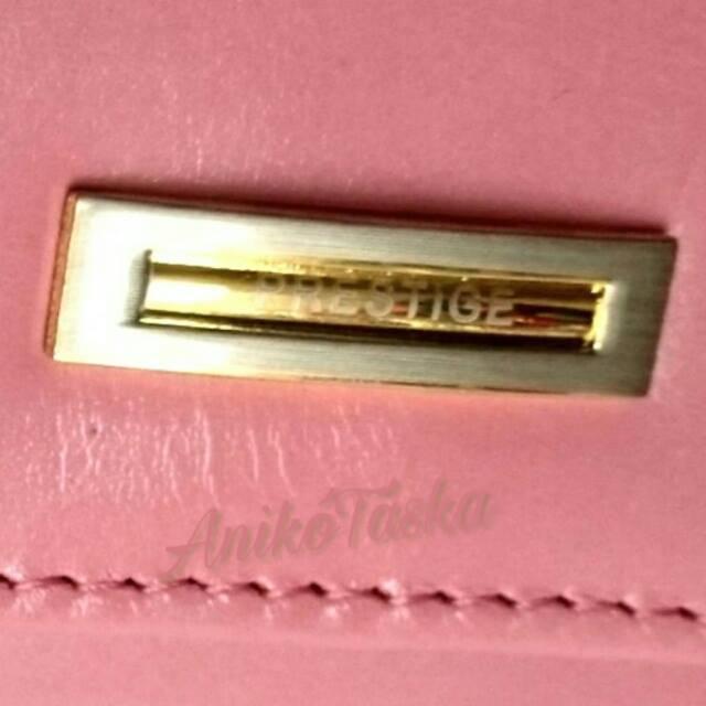 Sötét púder színű kártyatartós keretes bőr női pénztárca